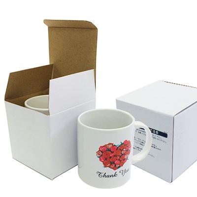 マグカップの通常個装箱。裏面に取扱説明が印刷されています。